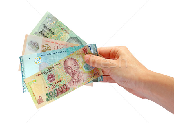 Hand holding asian currency isolated on white background Stock photo © happydancing
