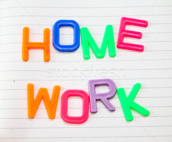 Homework in colorful toy letters on lined paper background  Stock photo © happydancing