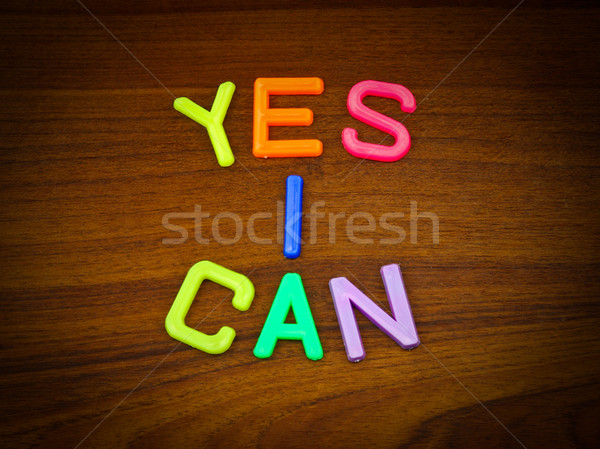 Yes I can in colorful toy letters on wood background  Stock photo © happydancing