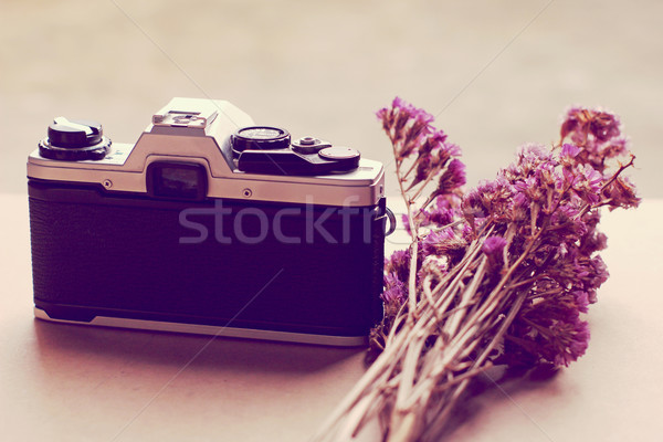Old camera and bunch of flowers with retro filter effect  Stock photo © happydancing