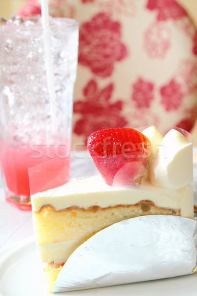 Piece of strawberry cake on white plate with cool drink Stock photo © happydancing