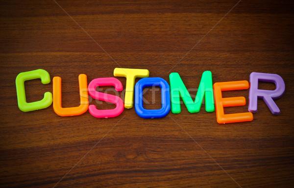 Müşteri renkli oyuncak harfler ahşap mektup Stok fotoğraf © happydancing