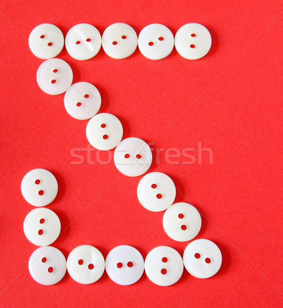 Letter 'S' from buttons on a red background  Stock photo © happydancing