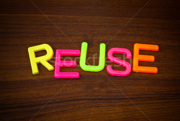 Reuse in colorful toy letters on wood background  Stock photo © happydancing