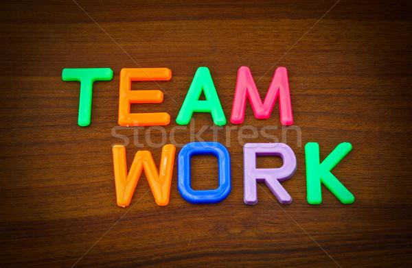 Takım çalışması renkli oyuncak harfler ahşap çalışmak Stok fotoğraf © happydancing