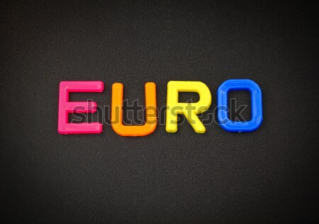 Rupee in colorful toy letters on black background Stock photo © happydancing
