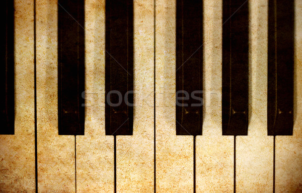 piano keys in grunge image retro background Stock photo © happydancing