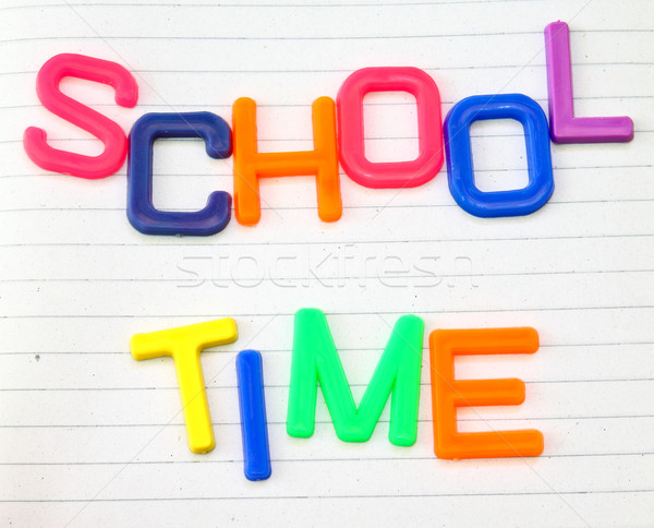 School time in colorful toy letters on lined paper background  Stock photo © happydancing