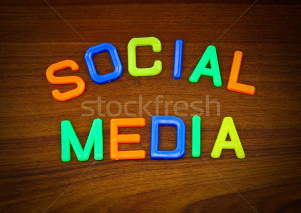 Social media kleurrijk speelgoed brieven hout wereld Stockfoto © happydancing