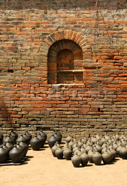 Many clay vases kept for drying with brick wall  Stock photo © happydancing