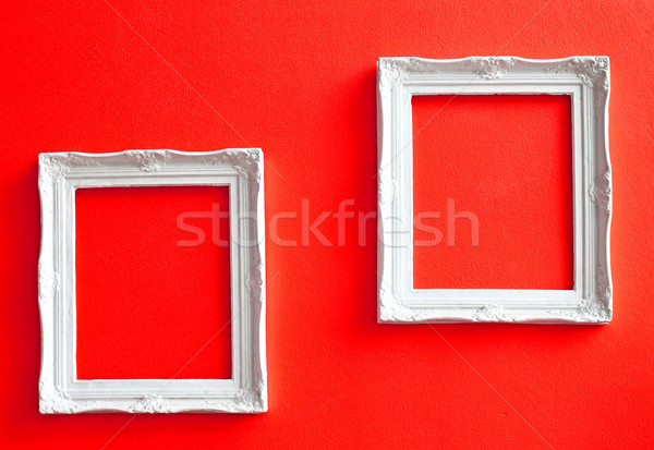 Two white vintage frames on red wall  Stock photo © happydancing