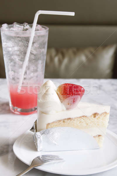 Piece of strawberry cake on white plate with cool drink in the c Stock photo © happydancing