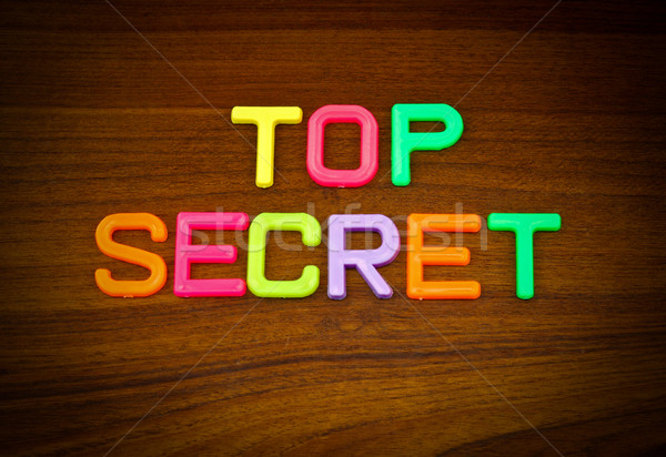 Top secret in colorful toy letters on wood background  Stock photo © happydancing