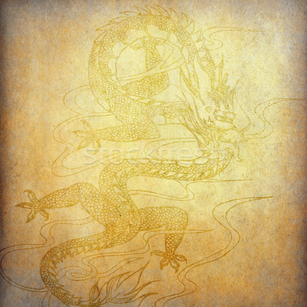 Chinese dragon on old paper background stock photo ...