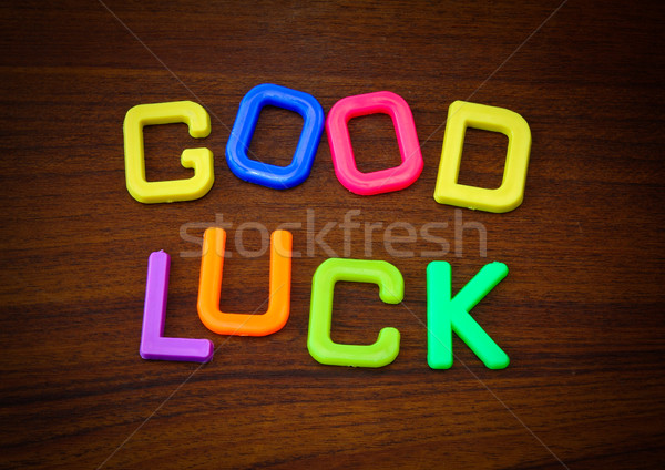 Good luck in colorful toy letters on wood background  Stock photo © happydancing