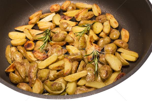 Alecrim batatas frigideira comida prato ferro Foto stock © haraldmuc