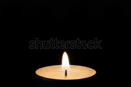 One burning tealight in darkness, closeup Stock photo © haraldmuc