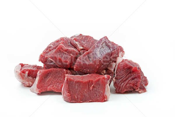 Pieces of raw beef goulash, isolated on white Stock photo © haraldmuc