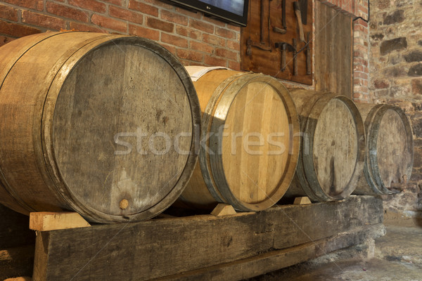 Old wine barrels in a cellar Stock photo © haraldmuc