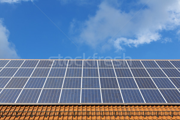 Stock photo: Solar panels on a new brick roof