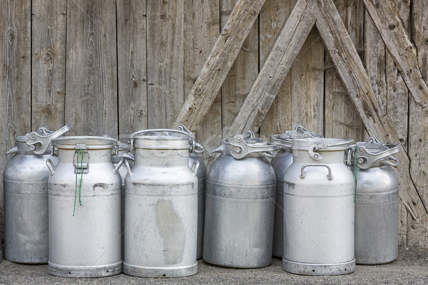Stock photo: Vintage milk cans in rural Northern Italy