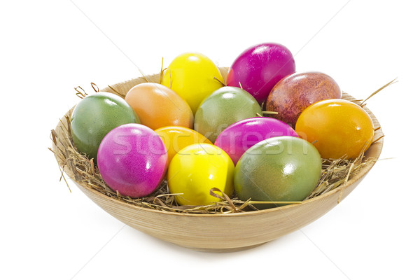 Easter eggs in a wooden bowl on white background Stock photo © haraldmuc