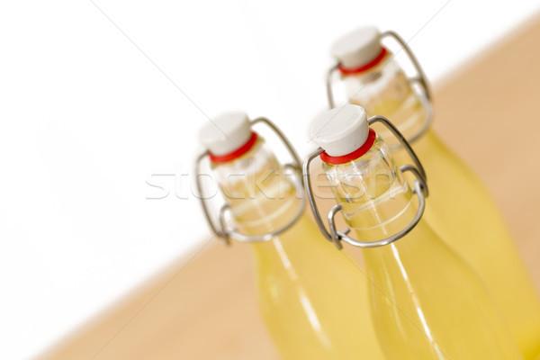 Bottles filled with elderflower syrup, shallow DOF Stock photo © haraldmuc