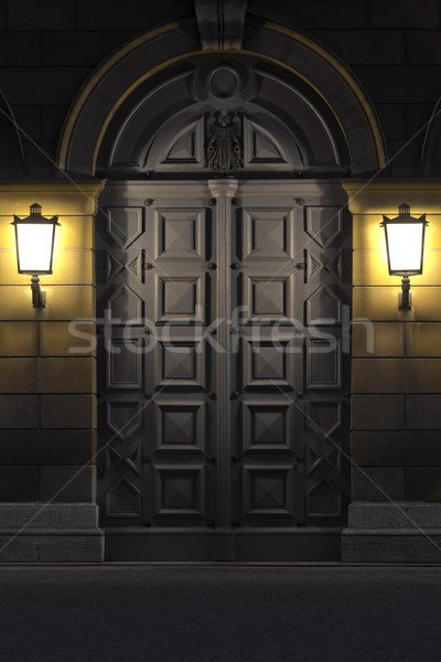 Two lanterns illuminating historic door Stock photo © haraldmuc