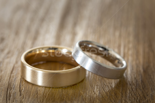 Two wedding rings on a wooden surface Stock photo © haraldmuc