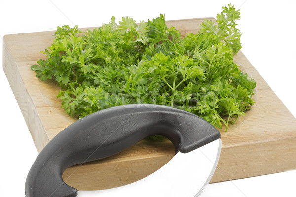 Fresh parsley on a wooden chopping board Stock photo © haraldmuc