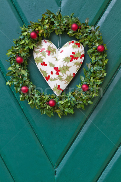 Christmas wreath hanged on a wooden door Stock photo © haraldmuc