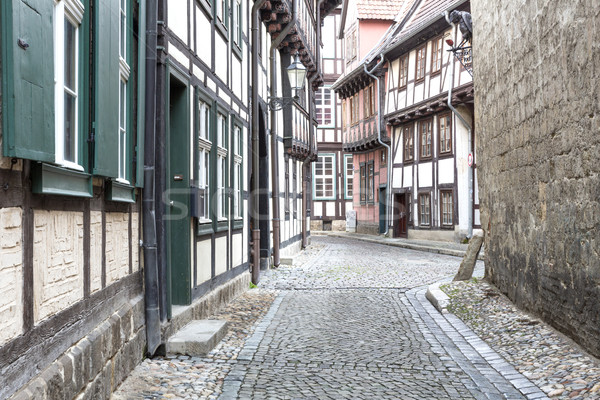 Alleyway with half-timbered houses in Quedlinburg town, Germany Stock photo © haraldmuc
