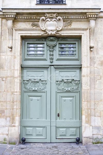 Historic wooden door, seen in Paris, France Stock photo © haraldmuc