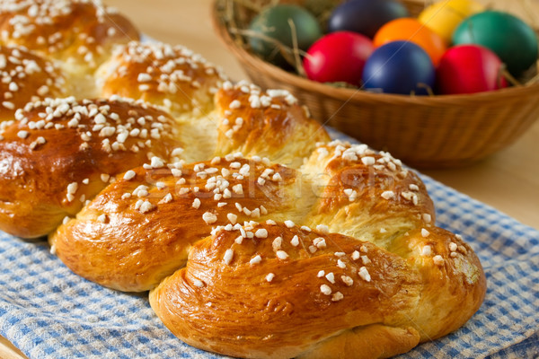 Stock photo: Sweet braided bread with easter eggs