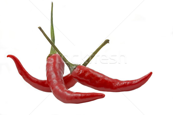 Three red hot chilies isolated on white background Stock photo © haraldmuc