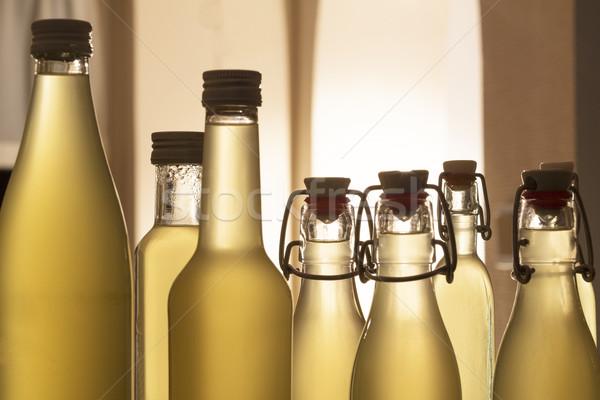 Bottles filled with elderflower syrup Stock photo © haraldmuc