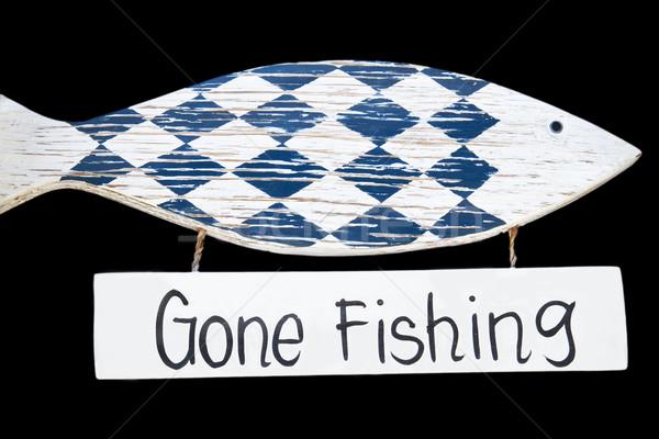 Wooden gone fishing sign, isolated on black background Stock photo © haraldmuc