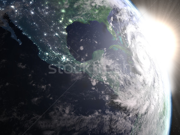 Hurricane Matthew during sunrise from space Stock photo © Harlekino