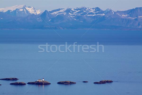 Small lighthouse in norwegian sea Stock photo © Harlekino