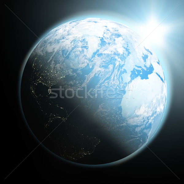 Sun rising over blue Earth Stock photo © Harlekino