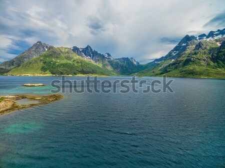 Mountain peaks around fjord Stock photo © Harlekino