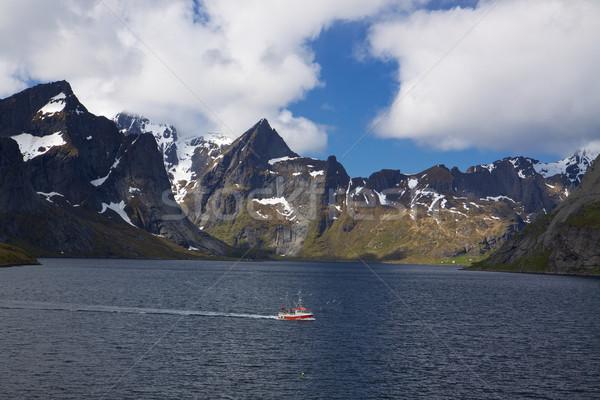 Fishing boat in fjord Stock photo © Harlekino