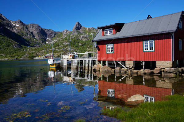 Fishing hut reflecting in fjord Stock photo © Harlekino
