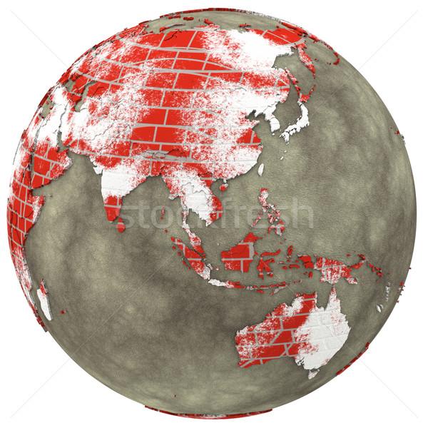 Asia on brick wall Earth Stock photo © Harlekino