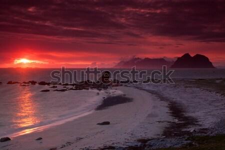 éjfél nap sziget szigetek Norvégia naplemente Stock fotó © Harlekino