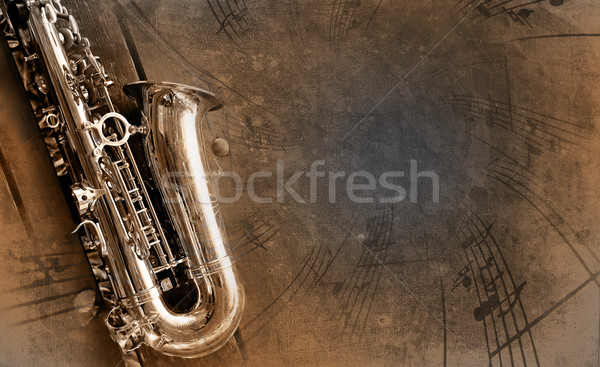 Old Saxophone with dirty background Stock photo © Hasenonkel
