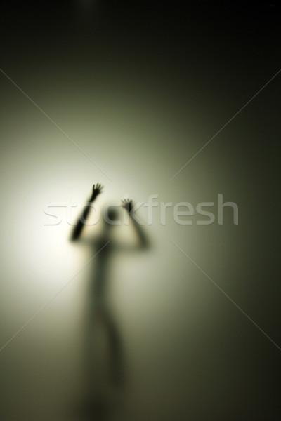 Pessoa atrás vidro de volta luz corpo Foto stock © Hasenonkel