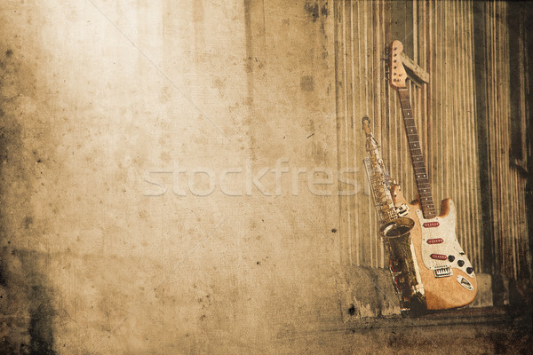 old grungy sax with electric guitar in retro look Stock photo © Hasenonkel