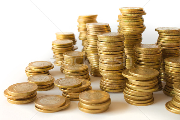 Piles of golden coins on white background, mexican ten pesos coins Stock photo © hayaship