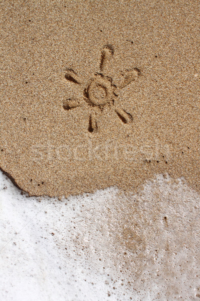 Drawing of sun in the sand Stock photo © hayaship